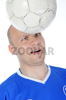 Football player takes the ball head.