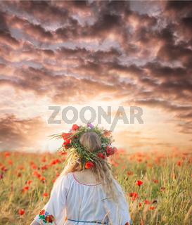 Girl in a poppy field