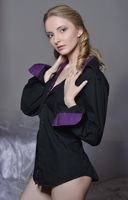 Beautiful woman in black blouse and panties.