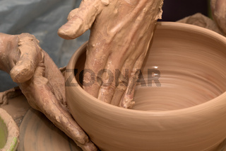 Process of making clay bowl on pottery wheel