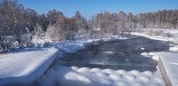 Dam between pond of Kokshi and river Koksha in Altai region in winter season