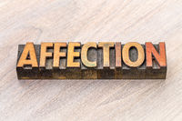 affection word abstract in wood type
