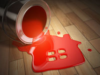 House renovation or construction concept. Can with spilled red paint and house symbol.  Paint your home.