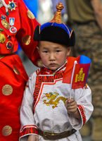 Boy wearing the traditional deel costume and typical velvet hat with the cone shaped top,Mongolia