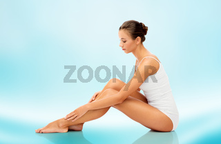 beautiful woman touching her smooth bare legs