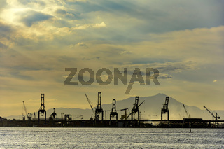 Harbour cranes at sunset