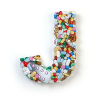 Letter J. Set of alphabet of medicine pills, capsules, tablets and blisters isolated on white.