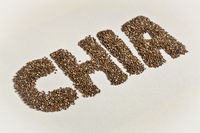 chia seeds and word on white canvas