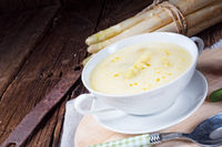rustic white asparagus cream soup with butter