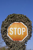 Stop sign with plants