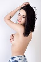 Beautiful woman with naked torso from back side.