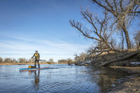 Expedition winter stand up paddling on South Platte RIver