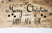 Calligraphy Merry Christmas And Happy New Year, Wooden Background, Snow