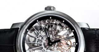 Elegant watch with visible mechanism, clockwork close-up.