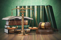 Gold scales of justice, gavel and books with differents field of law. Justice concept.