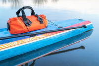 waterproof duffel on stand up paddleboard
