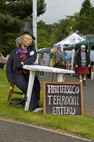 Life-size doll at the entrance to the fairground of the Ceres Highland Games, Ceres, Scotland, UK