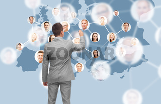 businessman at virtual screen with contacts