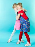 Twin sisters hugging