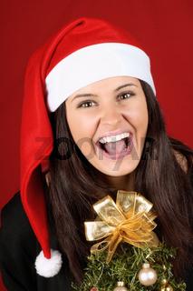 Santa Claus girl with Christmas tree