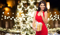 beautiful woman in red dress with christmas gift