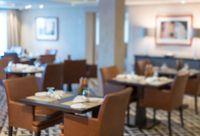 Defocused interior of modern restaurant