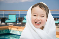 Happy Cute Mixed Race Chinese and Caucasian Boy On Cruise Ship Wrapped In A Towel
