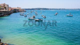 boats in sea near promenade foro italico
