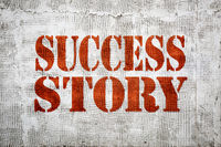 success story sign painted on grunge stucco texture wall