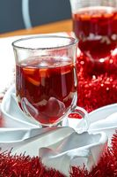 Hot mulled wine in a glass cup