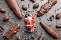 Delicious festive Christmas chocolate and sweets on rustic background