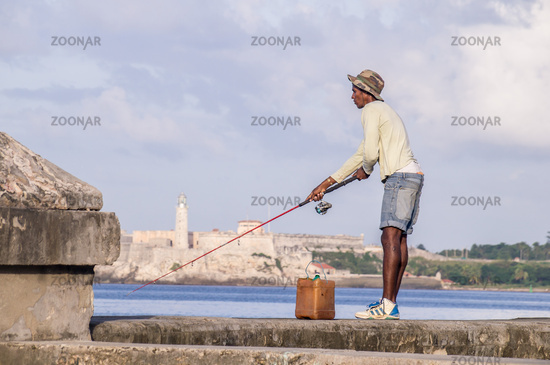 Cuban Fisherman with rod on Malecon in front of Castillo
