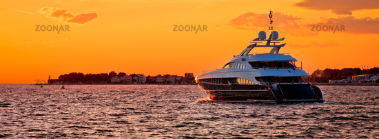 Yachtig on open sea at golden sunset panoramic view