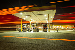 busy fueling gas station at night in USA