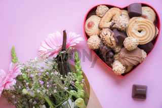 Heart shaped box with cookies and flowers