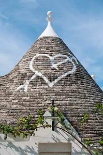Symbol in the Trullo conical rooftop in Alberobello, Apulia, Italy