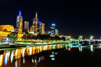 A beautiful view of Melbourne downtown across the Yarra river at night in Melbourne, Victoria, Austr