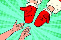 Hand of Santa Claus and women