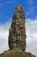 Person in size comparison to the rock pinnacle The Old Man of Storr, Skye, Scotland, Great Britain