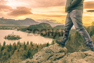 Hiker legs and view over Lake Bled