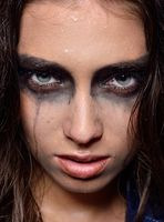 Woman's face  with wet stage make up