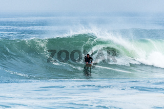 Bodyboarder surfing ocean wave