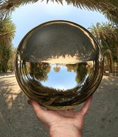 Glass sphere in hand. Vai. Crete