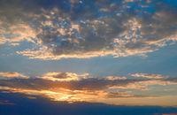 Sunset in the sky, warm light of setting sun
