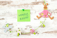 easter greetings on wooden background
