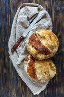Homemade freshly baked bread on linen cloth.