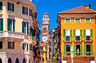 Verona colorful street and Lamberti tower view