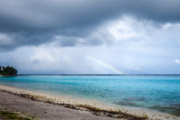 Rainbow on Temae Beach lagoon in Moorea island