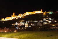 ancient fortress on a mountain in the night
