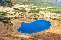Lake in mountains with blue water
